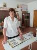 Учитель истории  жаны-жерской школы Ольга Васильевна Шаклова в кабинете, посвящённом Андрею Велько